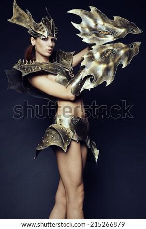 Woman in fantasy metallic armor - stock photo