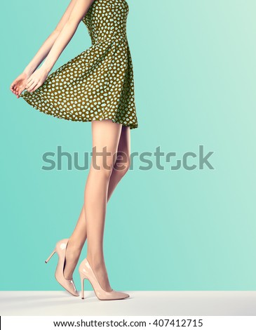 Woman in fashion vintage dress and high heels. Perfect female sexy long legs, stylish green skirt and summer glamour shoes. Unusual creative elegant walking out outfit, people.  Vintage, copy space - stock photo