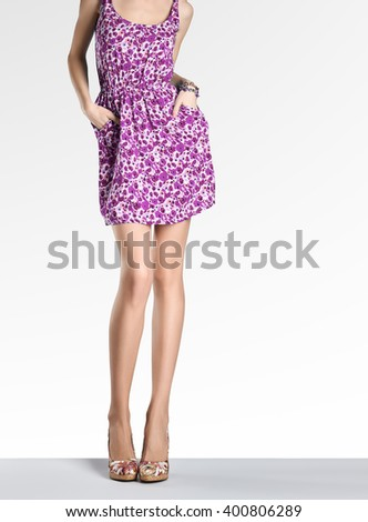 Woman in fashion vintage dress and high heels. Perfect female sexy long legs, stylish purple flower sundress and summer glamour shoes. Unusual creative elegant walking out outfit, people. Copy space - stock photo