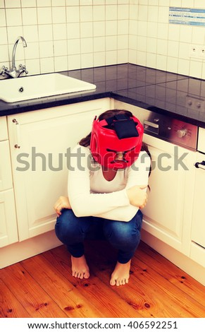 Woman in fear of domestic abuse. - stock photo