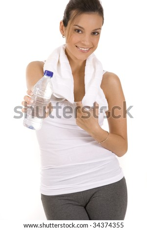 Woman in fitness pose holding a water bottle