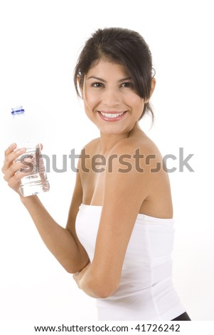 Woman in fitness pose holding water bottle. - stock photo