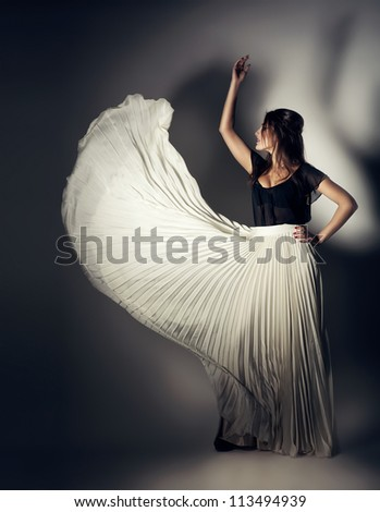 woman in flying white skirt - stock photo
