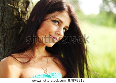 woman in forest close up portrait - stock photo