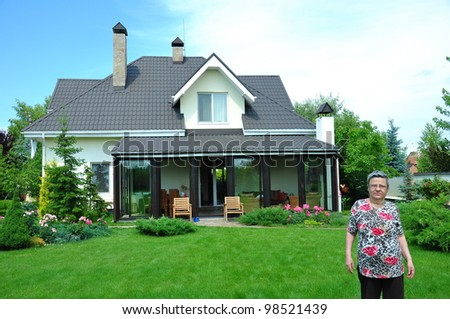 woman in front of a house - stock photo