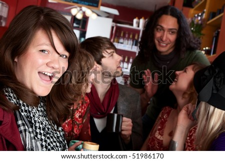 Woman in front of diverse friends in a coffee house - stock photo