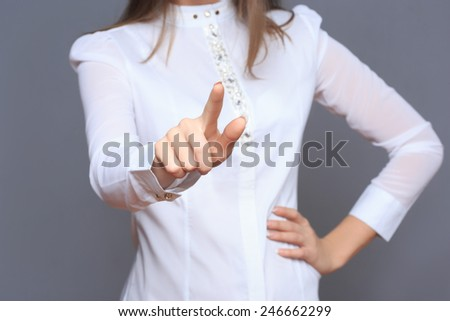 woman in front of visual touch screen. - stock photo