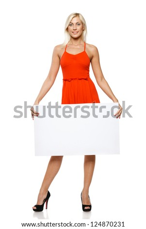 Woman in full length holding empty banner, over white background - stock photo