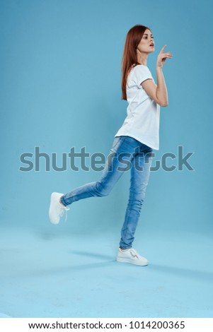 woman in full-length jeans on a blue background
