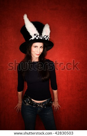 Woman in funny big hat with rabbit ears - stock photo