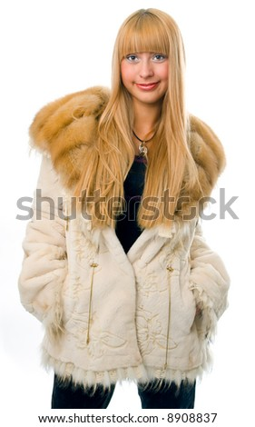 woman in fur over white background