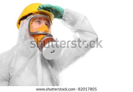 Woman in gas mask and bio-hazard suit on white background. - stock photo