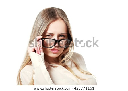 Woman in glasses on white background looking suspiciously - stock photo