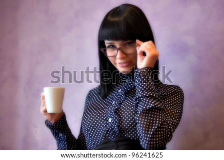 woman in glasses with cup in hand - stock photo