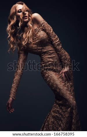 woman in gold dress - stock photo