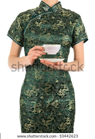 Woman in green Chinese dress holding a cup of tea. - stock photo