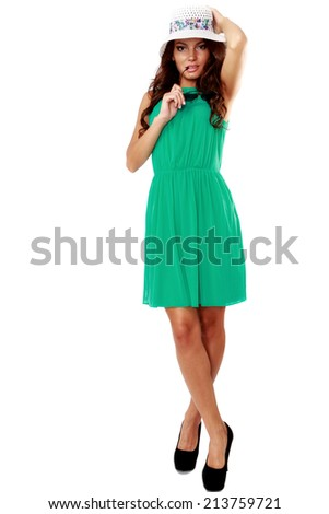 woman in green dress and sun hat isolated on white background - stock photo