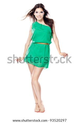 woman in green dress barefoot, isolated on white background - stock photo