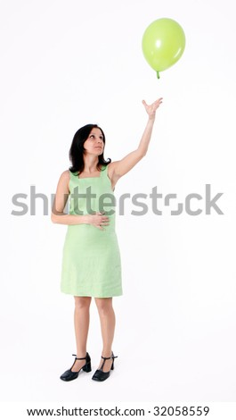 woman in green dress with green balloon - stock photo