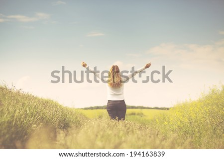 Woman in green field