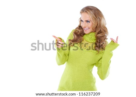 Woman in green sweater pointing out something - stock photo