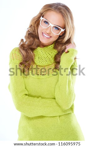 Woman in green warm sweater and white glasses isolated - stock photo