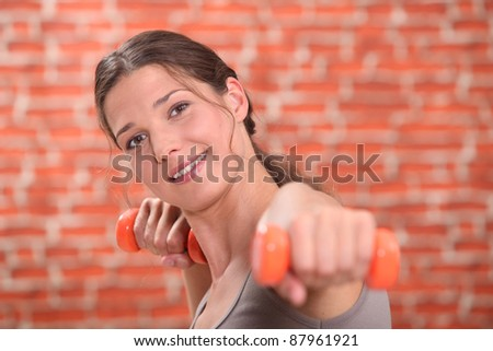 Woman in gym class - stock photo