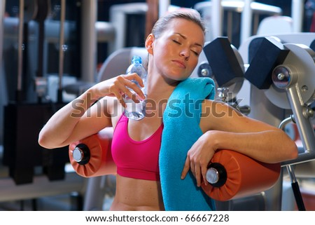 Woman gym drink water after exercise stock photo 66667231 woman in gym cooling herself with water bottle sciox Gallery