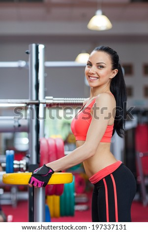 Woman in gym smile, sport exercising young girl working out - stock photo