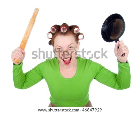 Woman in hair rollers is holding . Very frustrated and angry mad woman. Angry look on face. Studio, white background. - stock photo