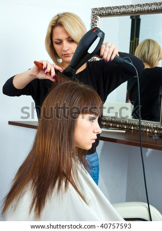 woman in hair salon having treatment