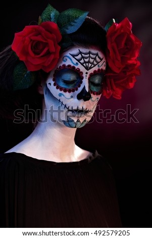 Woman in Halloween makeup - mexican Santa Muerte mask.