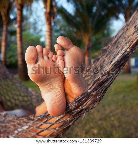 woman in hammock - stock photo