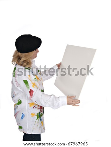 woman in hat and painted shirt looking at blank poster board - stock photo