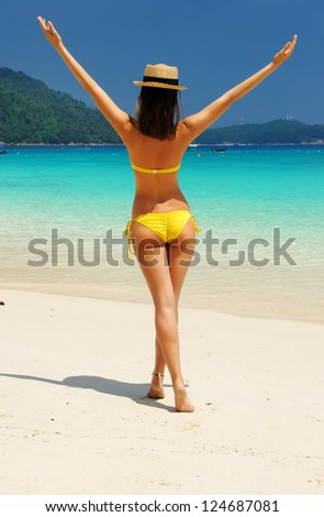 Woman in hat at beach - stock photo