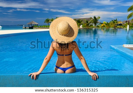 Woman in hat at the pool - stock photo