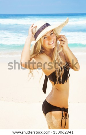 woman in hat on the beach - stock photo