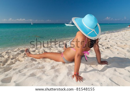Woman in hat relaxing on holiday at Caribbean Sea