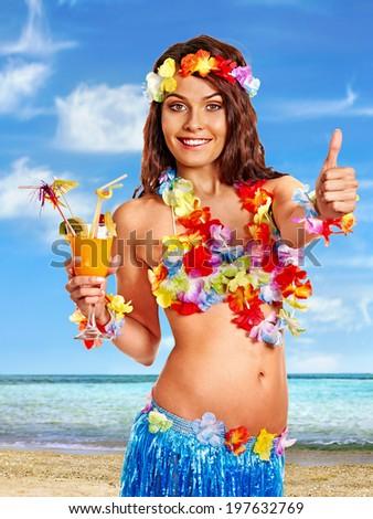 Woman in hawaii costume drink  juice. - stock photo