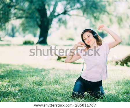 Woman in headphones - stock photo