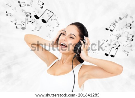 woman in headphones listen to music smile sing with notes fly around - stock photo
