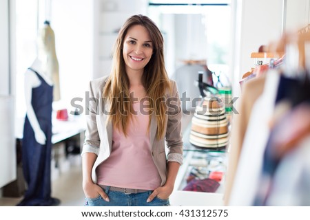 Woman in her clothing boutique  - stock photo