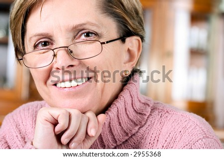 Woman in her fifties smiling, portrait. - stock photo