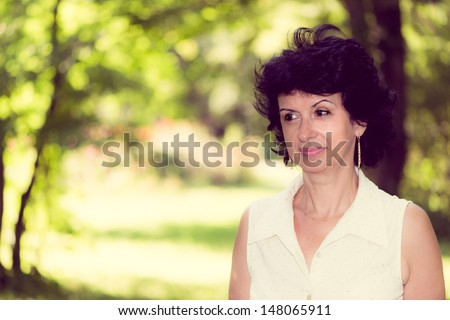 Woman in her 50s looking pensive - stock photo