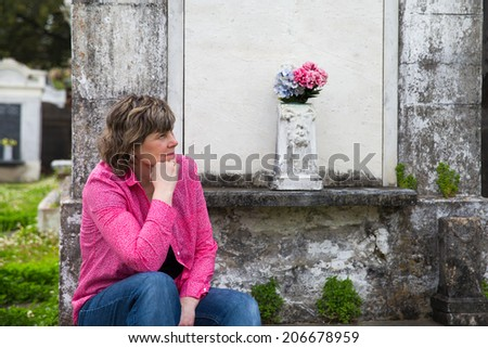 Woman in historic New Orleans cemetery. - stock photo