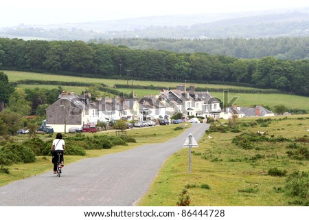 Woman in holidays cycling around Cornwall and Devon