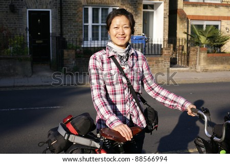 Woman in holidays cycling around Windsor
