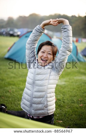 Woman in holidays in a campsite giving pose near her tent.  - 03