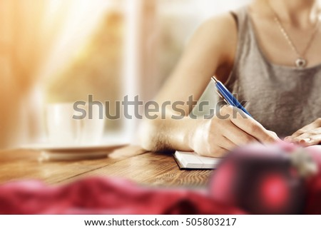 Woman home interior writing letter santa stock photo 505803217 woman in home interior writing letter to santa claus and blurred red ball of xmas time spiritdancerdesigns Gallery