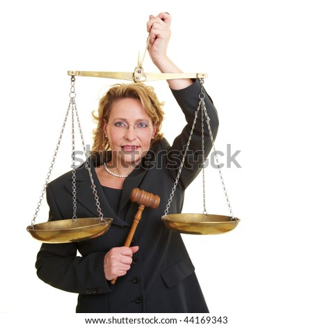 Woman in jacket with wooden hammer and scales - stock photo